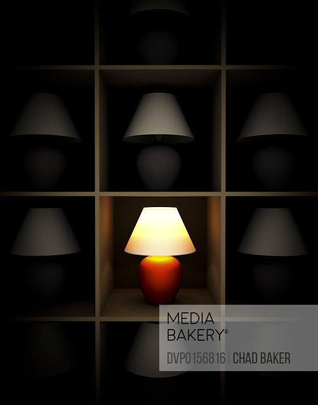 A single lamp lit among shelves of unlit lamps.