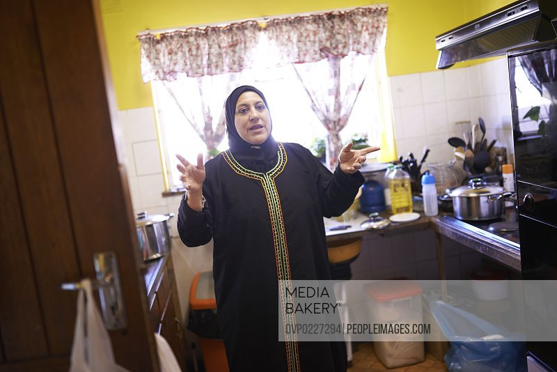 Shot of a mature muslim woman in her kitchen