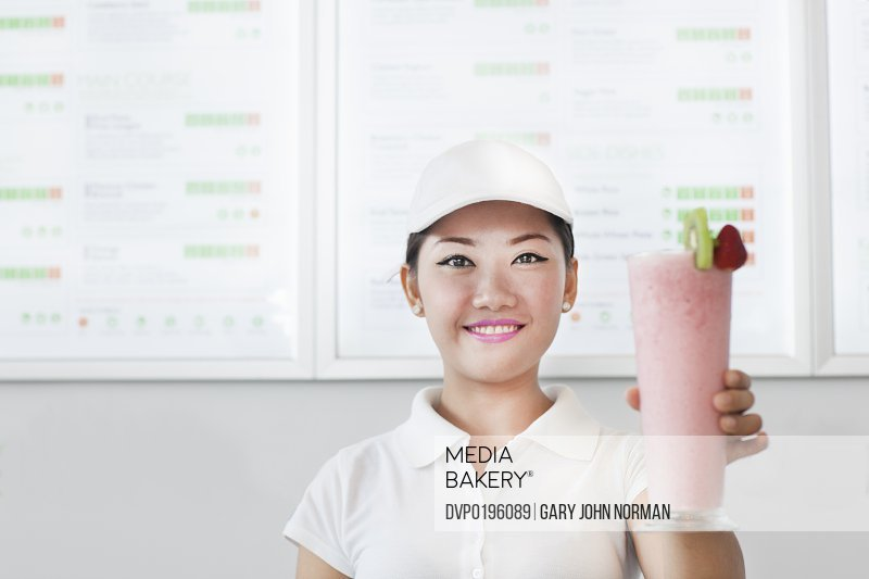 asian woman serving in healthy food restaurant