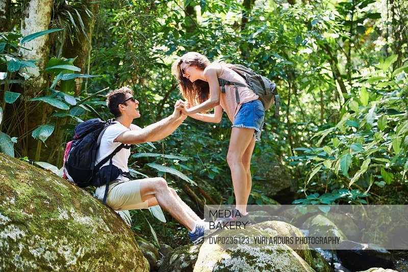 Shot of a young couple enjoying a hike in the forest