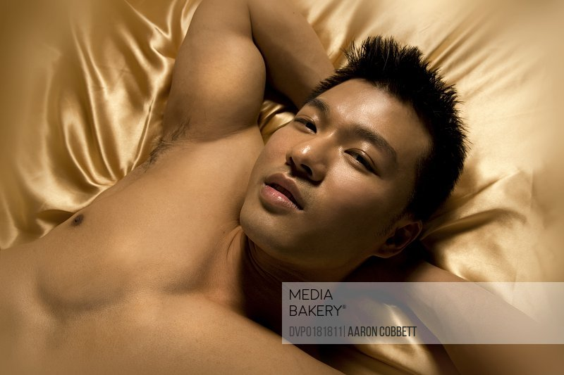 Asian male on bed portrait