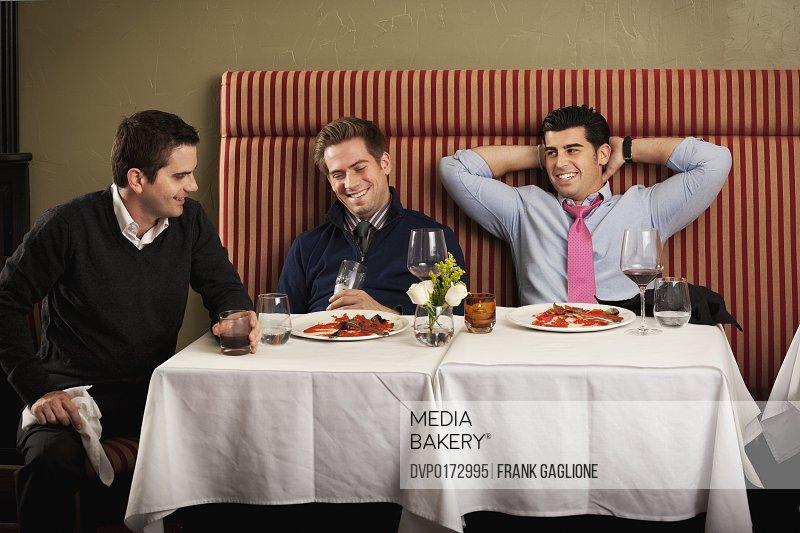 Three men after a big meal