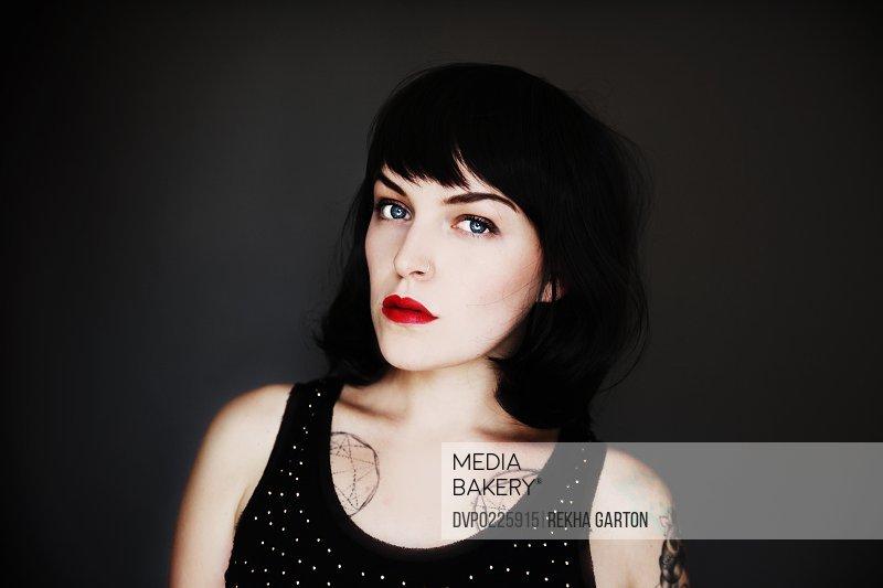 Beautiful young tattooed woman