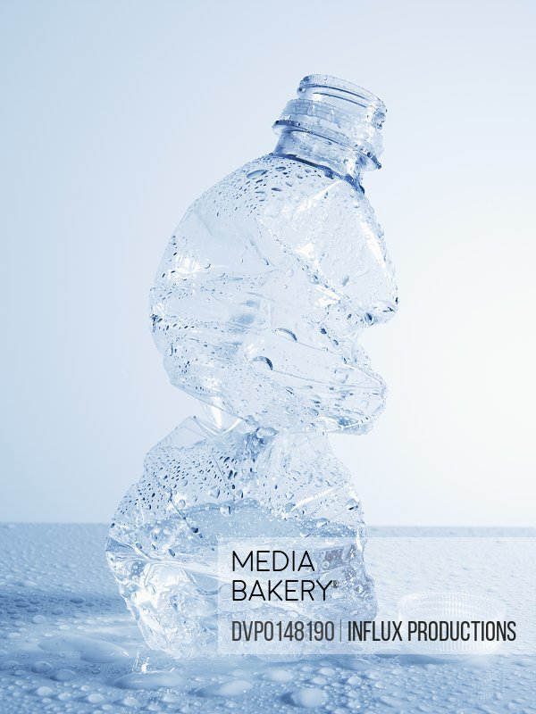 Crushed disposable plastic water bottle