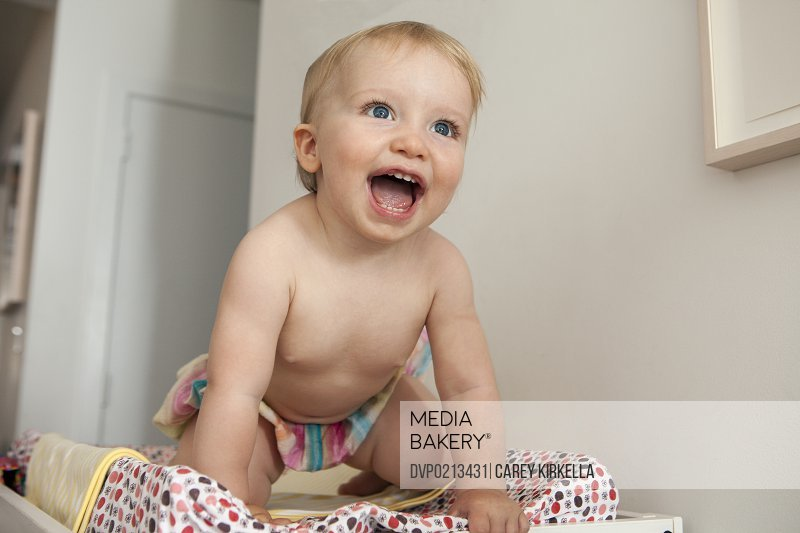 Excited baby on a changing table