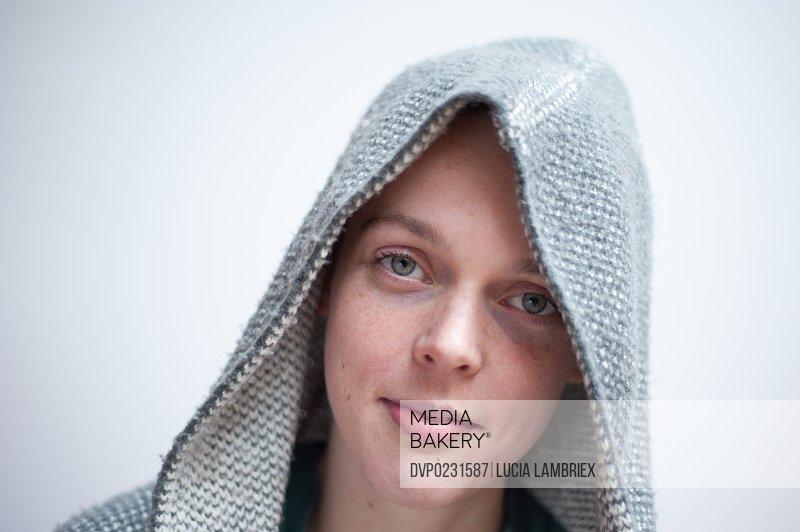 Young woman wearing woolen hoodie
