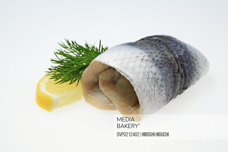Rollmops pickled herring with lemon Close-up