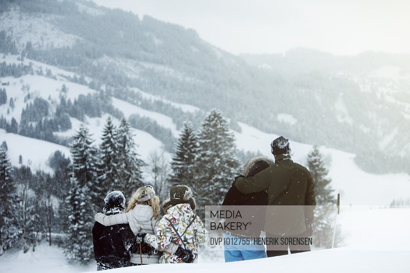 group of young people on winter holiday