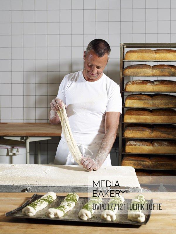 Baker making dough in bakery