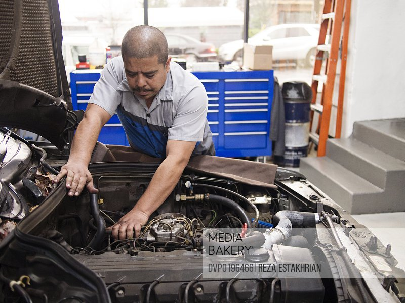 Mechanic works on auto