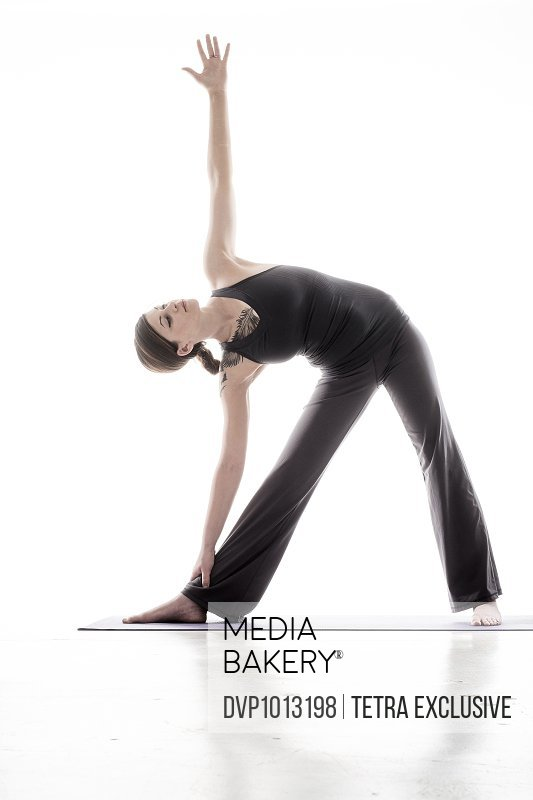 Young woman in triangle pose