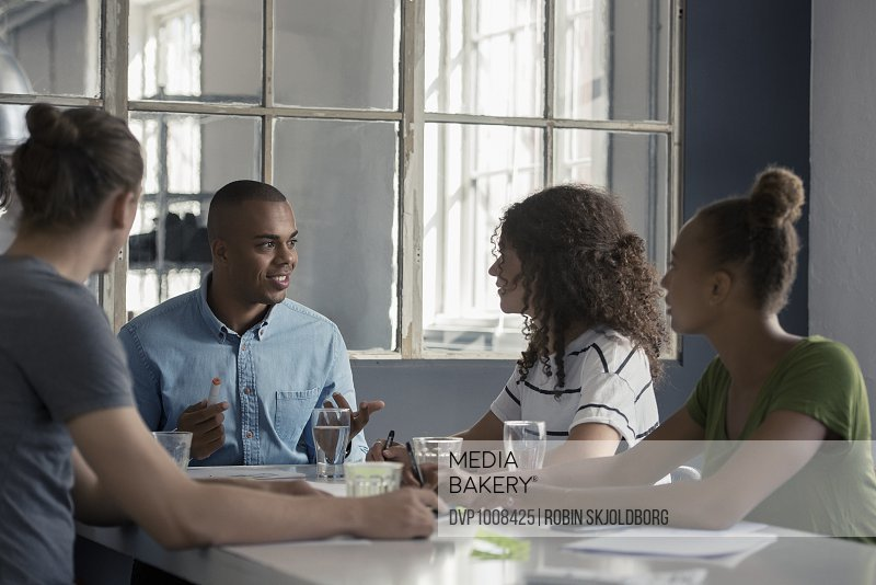 Young people having meeting