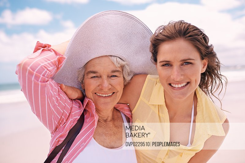 Shot of a young woman and her senior mother at the beach