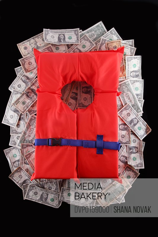 Life jacket on a pile of money