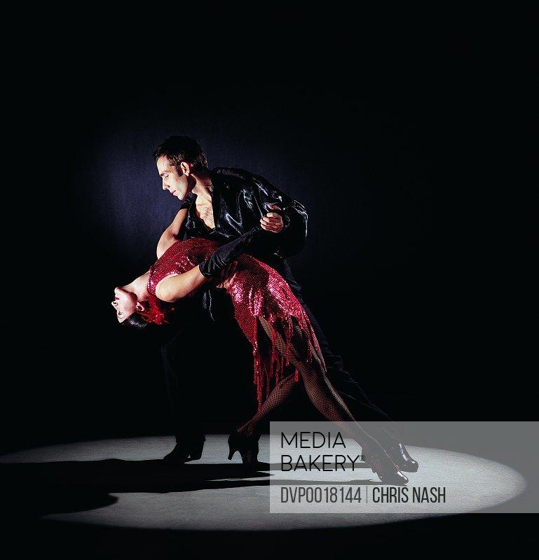 Male Dancer Supporting Female Dancer Bending Over