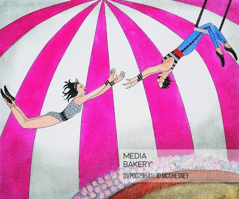 Male Trapeze Artist Swinging on a Trapeze Catching a Female Trapeze Artist
