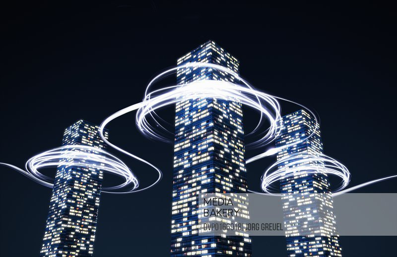 Light trails around high-rise buildings
