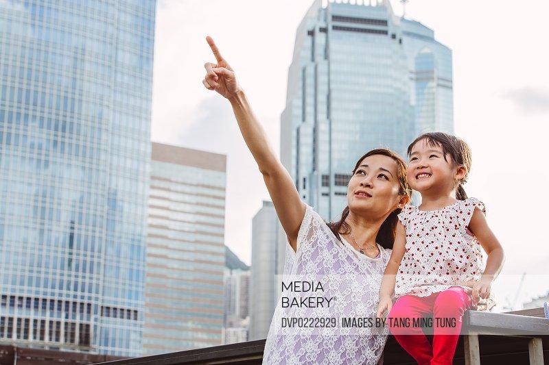 Mom child talking joyfully in commercial area
