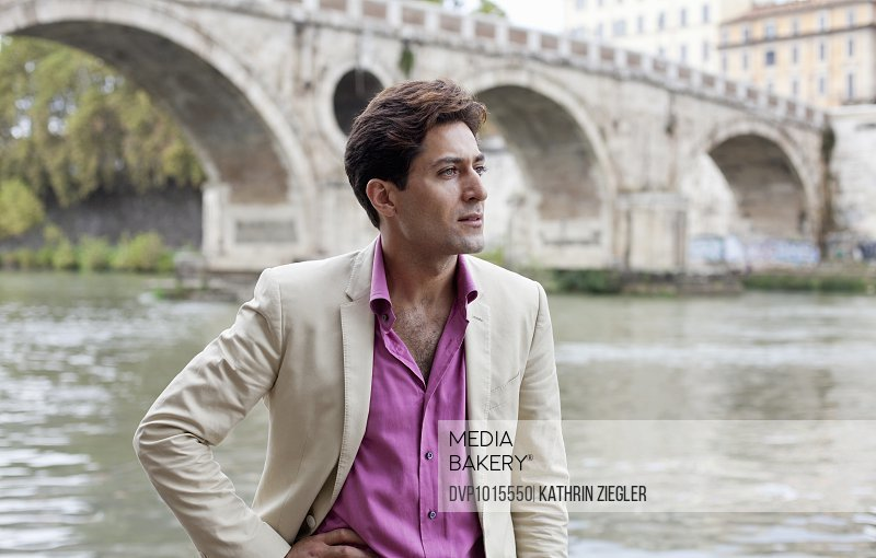 portrait of a man at the Tiber river, Rome, Italy