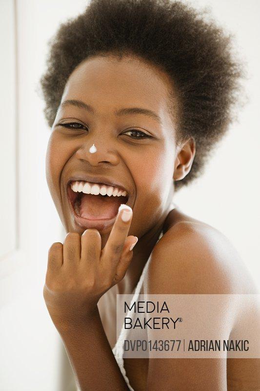 black girl applying fac