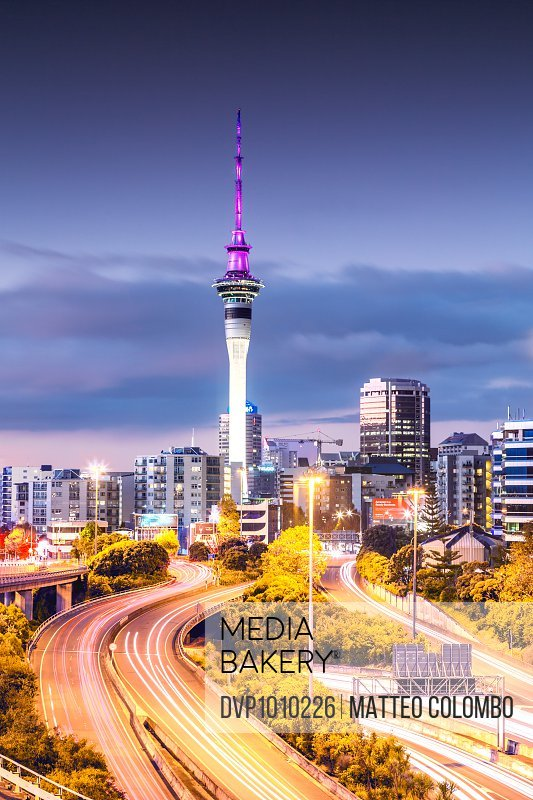 Long exposure of urban roads with traffic leading to Auckland city at dusk, North Island, New Zealand