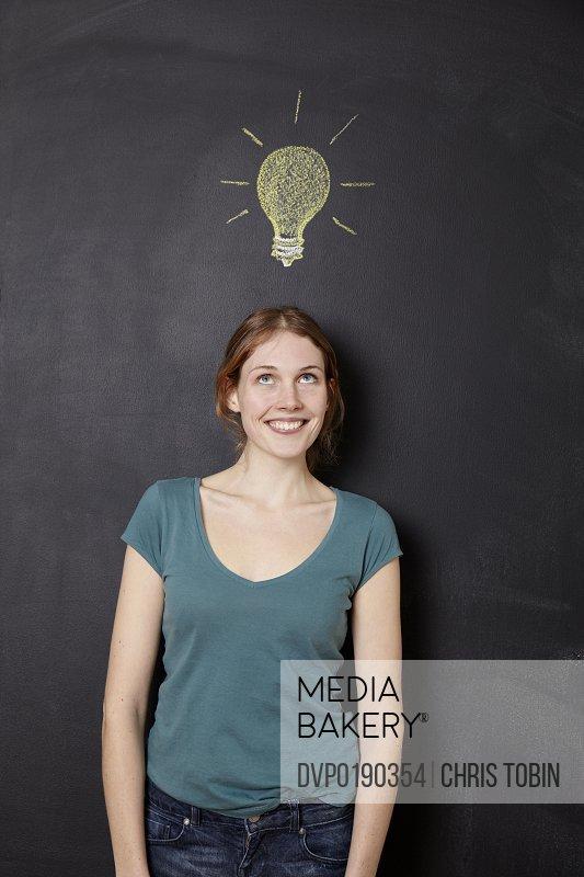 Girl with idea light bulb