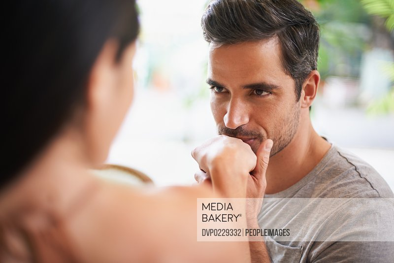 Shot of a charming man kissing his wifes hand at a restaurant