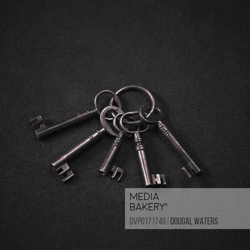 Set of old keys on black background