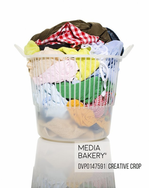 Cut out of Basket of dirty washing in laundry basket on white background with reflection