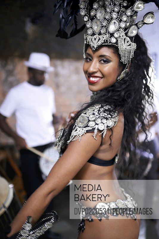Cropped shot of a beautiful female dancer with her band in the background