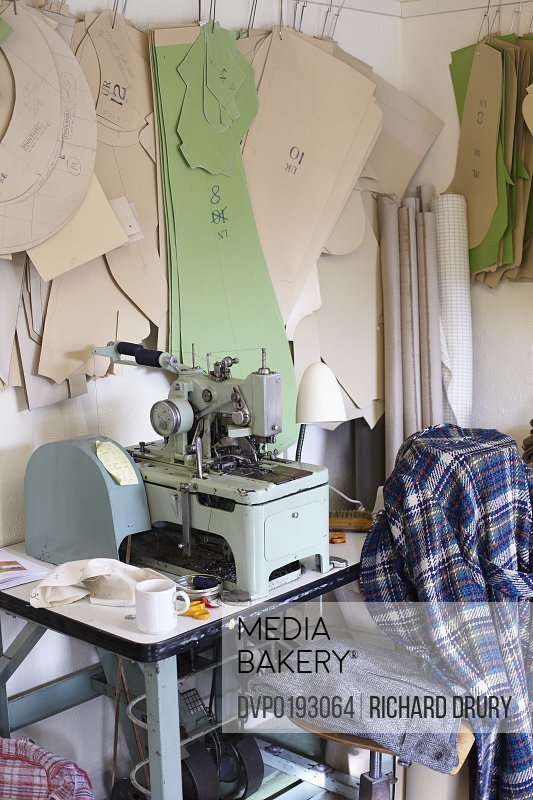 Sewing machine in clothing manufacturers workshop