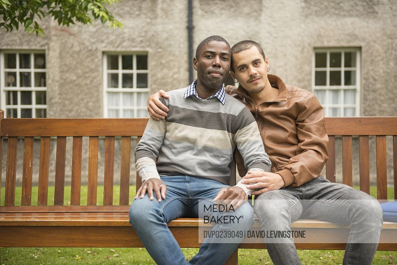 Handsome mixed race gay couple on college campus