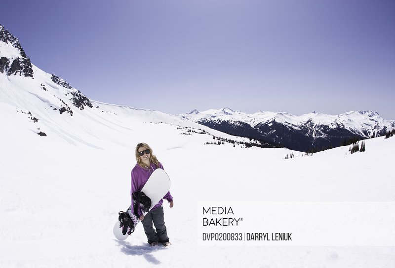Young female snowboarder.