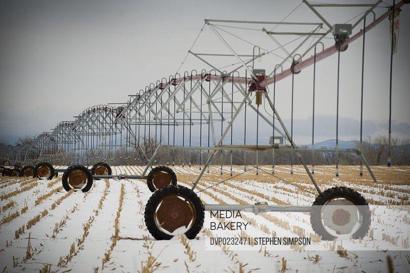 Idle watering equipment in winter field