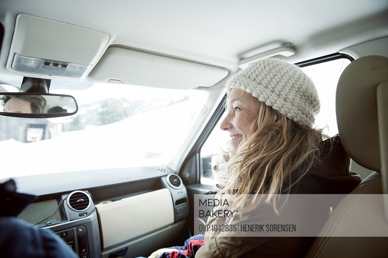 young woman in car, winter holiday