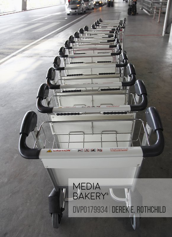 Row of luggage carts from high angle