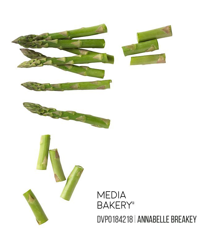 Spears of Chopped Asparagus on White Background