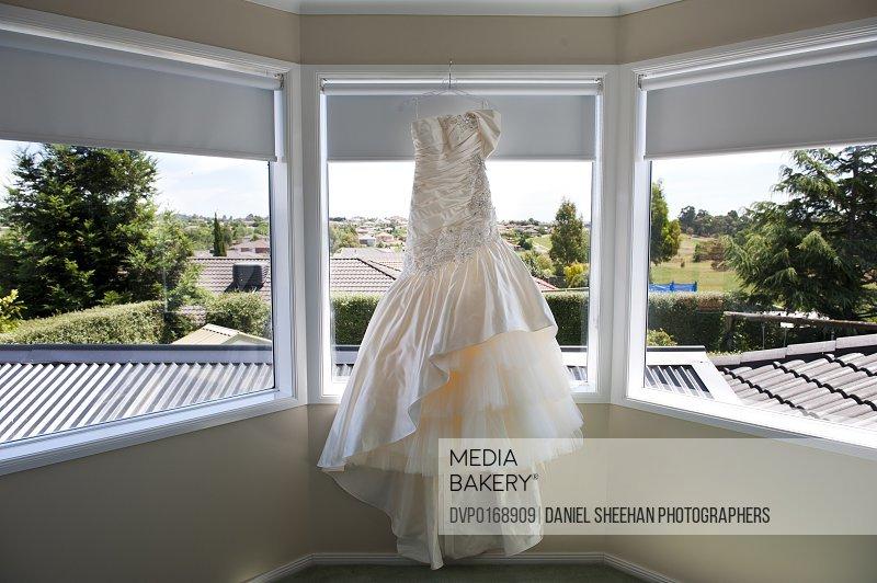 Wedding dress hanging on window