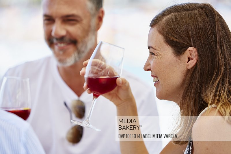 Woman having wine with friends