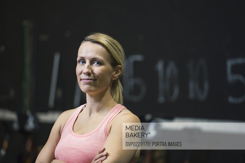 Portrait of confident female athlete at gym