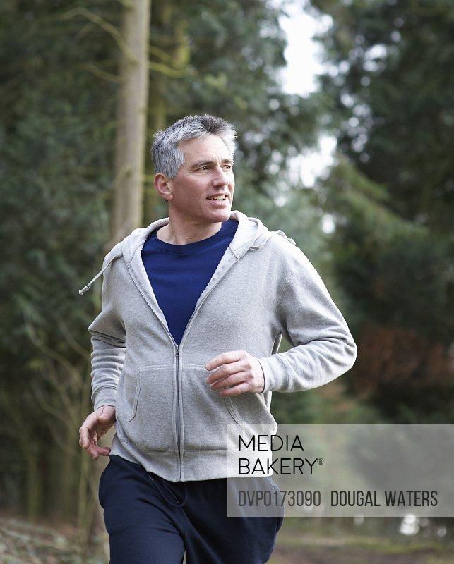 Man running in woodland
