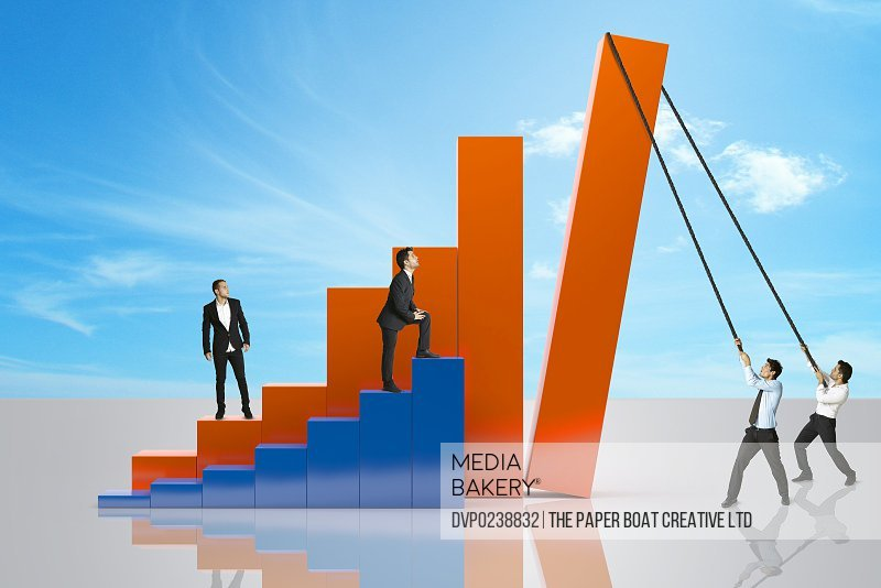 Group of businessmen fixing a giant line chart