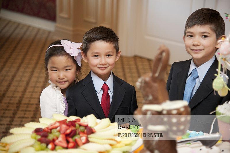 Kids at a dessert table
