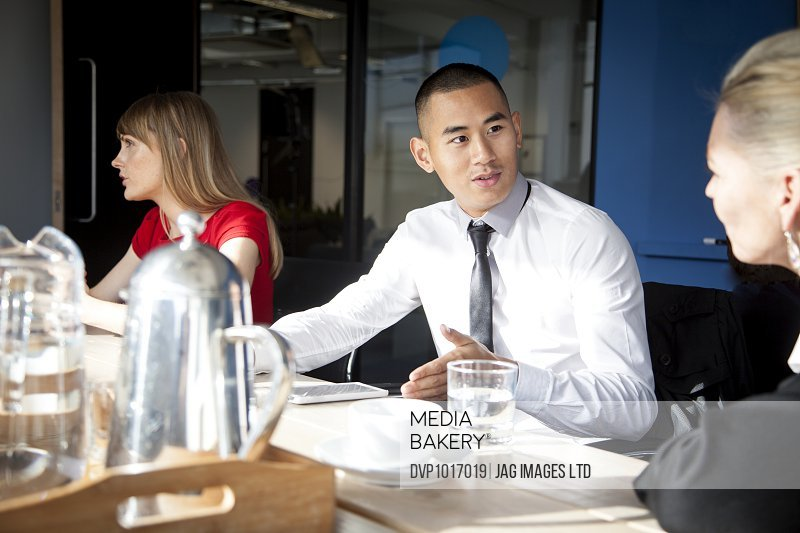 young asian business man in a meeting
