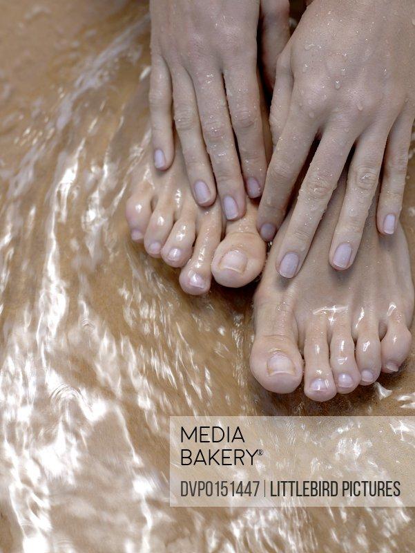 woman's feet in water