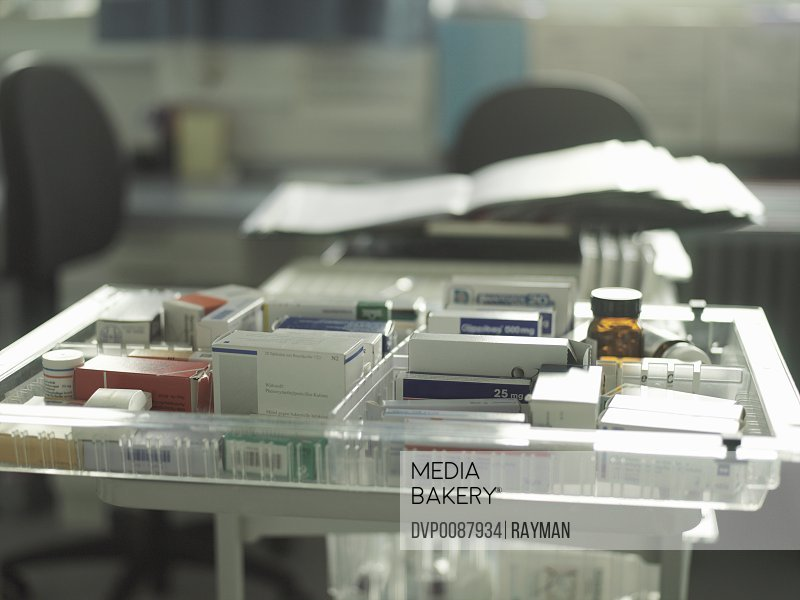 Tray of various medicines in hospital (focus on tray)