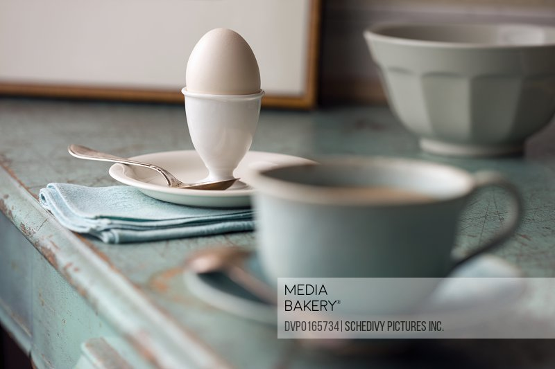 boiled egg in cup on breakfast table NY USA