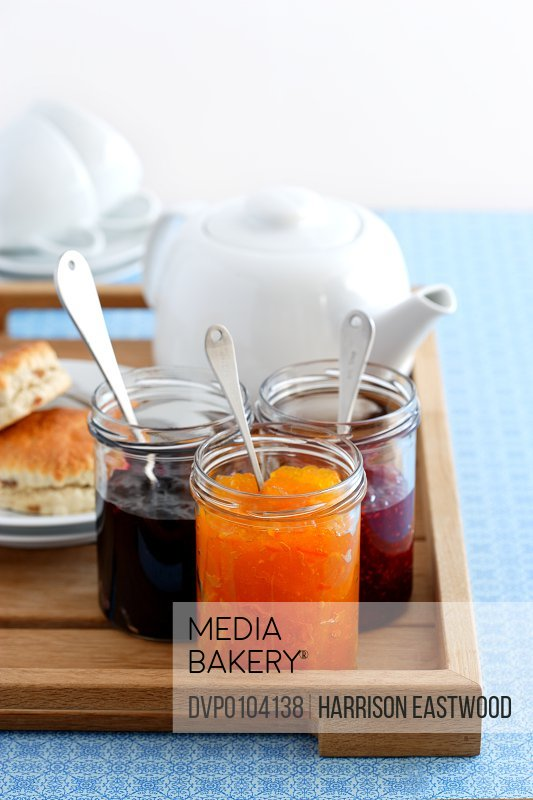 Three jars of jam on breakfast tray