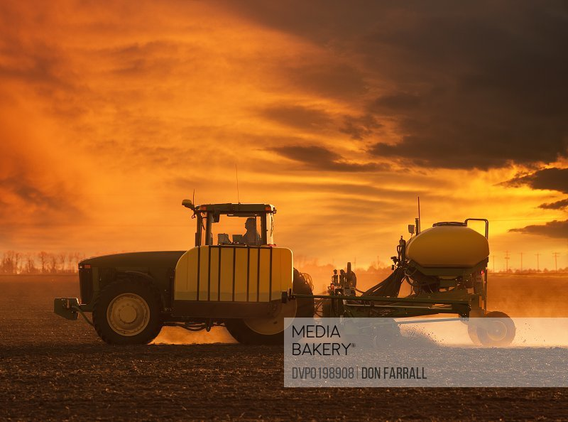 Planting tractor and planter sunset