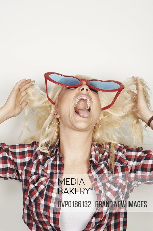 Portrait of woman wearing fun sun glasses